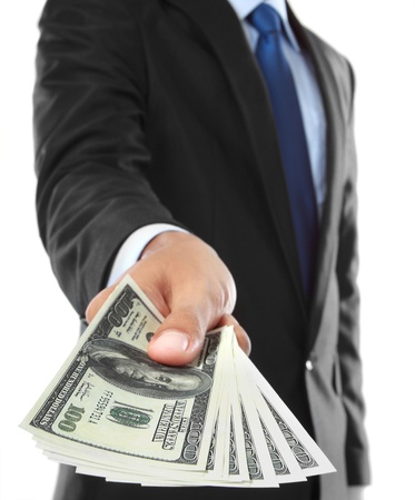 cash money: close up of businessmans hand offering money isolated over white background