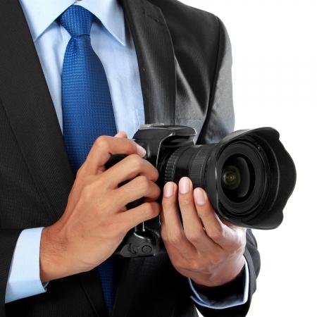 dslr camera: cropped portrait of professional photographer holding dslr camera
