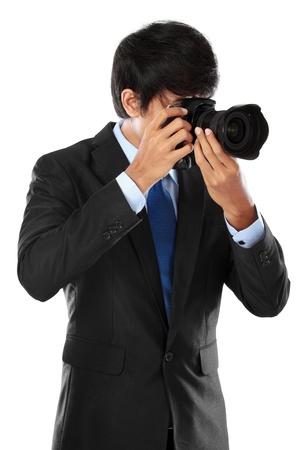 portrait of professional photographer ready to take photo using dslr camera photo
