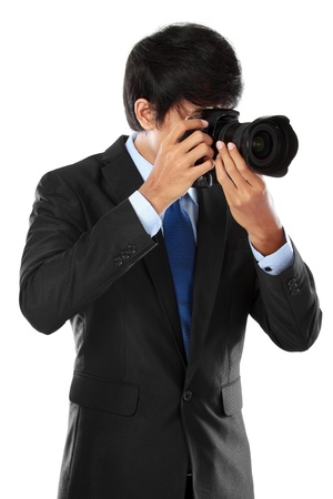 portrait of professional photographer ready to take photo using dslr camera Stock Photo - 14314674