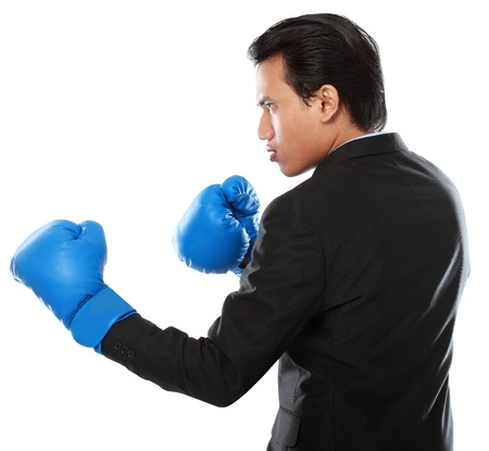 portrait of businessman with boxing glove punching photo