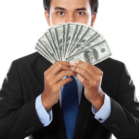 Portrait of a business man holding money, isolated on white photo