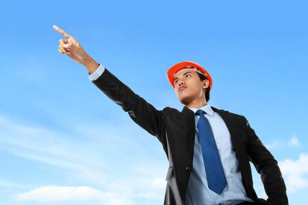 male architect pointing under the blue sky Stock Photo - 14373762