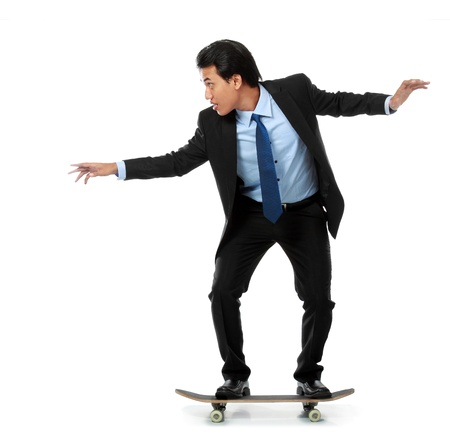 business man on skateboard isolated on white background photo