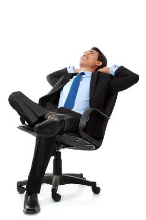 business man sitting and relaxing on chair - Isolated on white photo