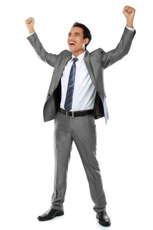 Excited business man with arms raised in success - Isolated on white photo