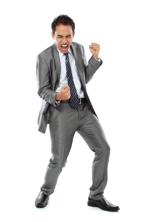 Excited business man with success expression on white background photo