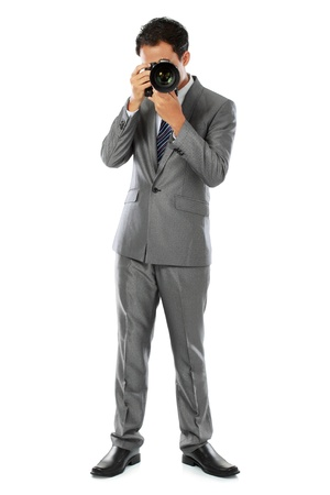 portrait of professional photographer ready to take photo using dslr camera Stock Photo - 14373741
