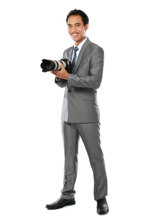 portrait of young professional photographer isolated over white background photo