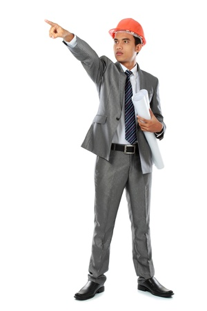 young handsome architect pointing. Isolated over white background photo
