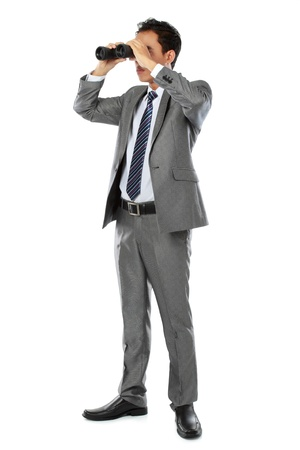 businessman standing and holding binocular isolated over white background photo