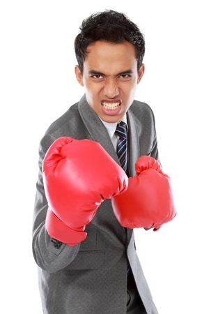 angry businessman with boxing glove photo
