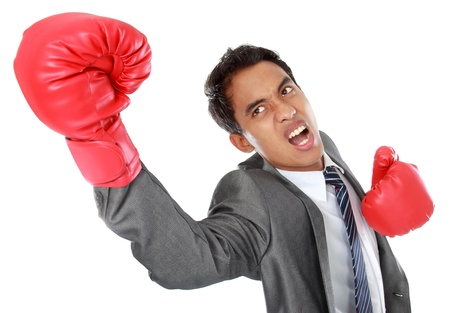 businessman with boxing glove uppercut photo