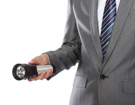 gesture of businessmans hand using flashlight photo
