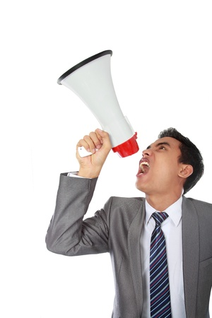 young man shouting using megaphone isolated on white background photo