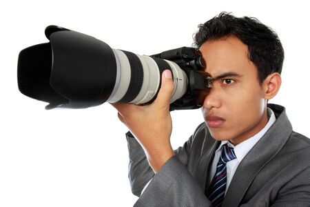 portrait of professional photographer ready to take photo using dslr camera photo