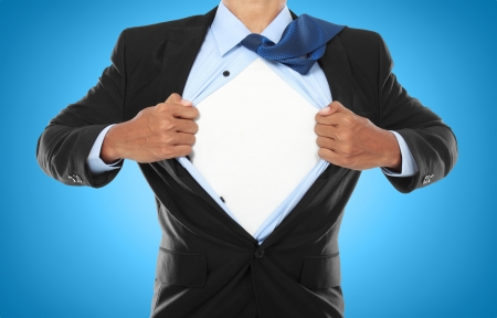 strip shirt: Businessman showing a superhero suit underneath his suit Stock Photo