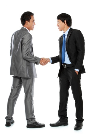 Full length of business colleagues shaking hands and smiling photo