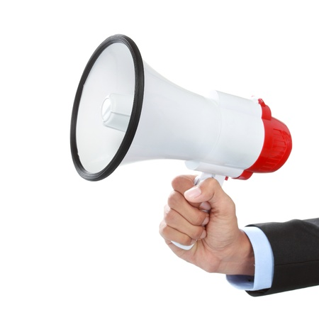 close up of businessmans hand holding a megaphone isolated on white background photo