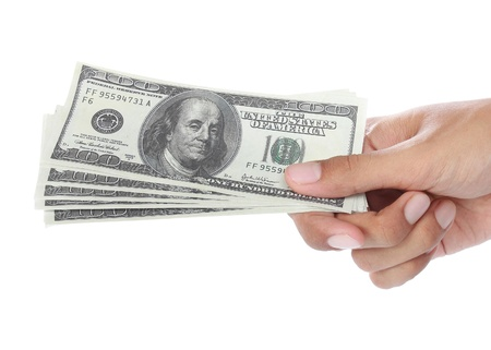 Hand with some money isolated on white background photo