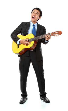 portrait of asian businessman playing guitar isolated on white background photo