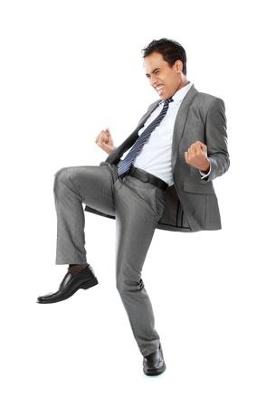 El éxito de Emocionado hombre de negocios la celebración aisladas sobre fondo blanco Foto de archivo