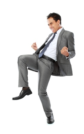 gente celebrando: El �xito de Emocionado hombre de negocios la celebraci�n aisladas sobre fondo blanco Foto de archivo