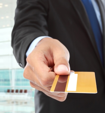 credit card payment: cropped image of hands paying using credit card