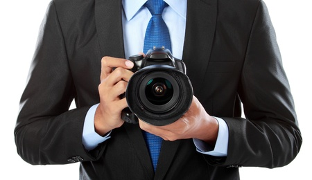 portrait of professional photographer holding a camera Stock Photo - 14572617