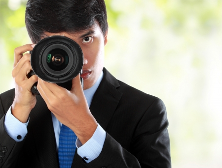 portrait of professional photographer with camera aiming Stock Photo - 14548634