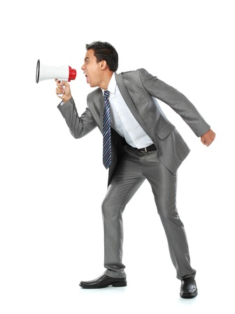 close up portrait of young man shouting using megaphone isolated on white background photo