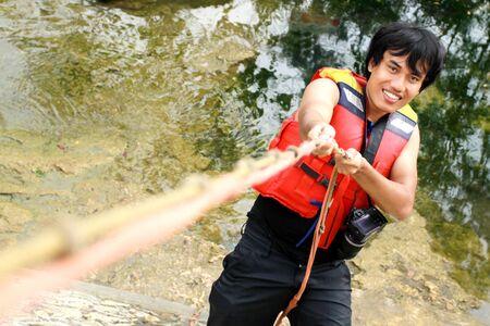 adventure climbing - man climbing using rope photo