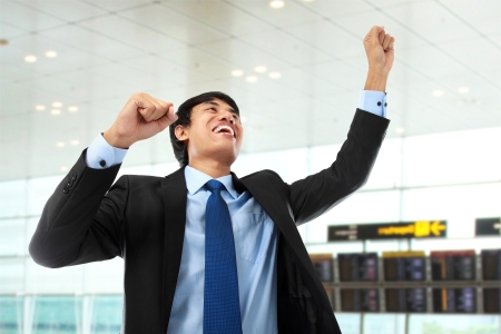 asian businessman: Excited business man celebrating success in the office Stock Photo