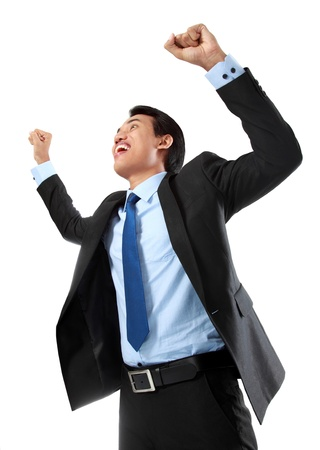 Excited business man celebrating success isolated on white background photo