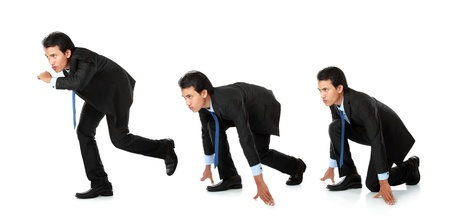 businessman getting ready for race in business photo