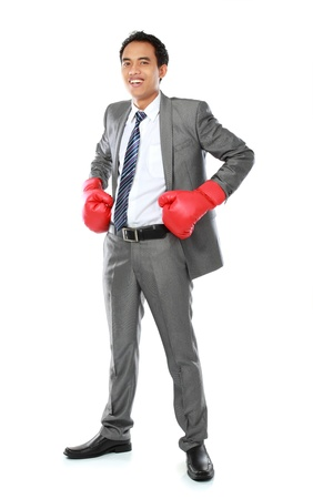 portrait of businessman with boxing glove smiling photo