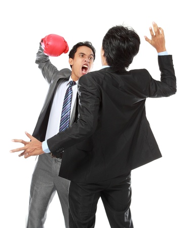 duel: two businessman having a fight isolated on white background Stock Photo