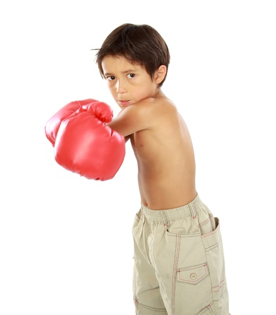 boy boxing: portrait of young boy with boxing glove