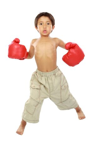 boy boxing: Young boy ready to box. isolated on white Stock Photo