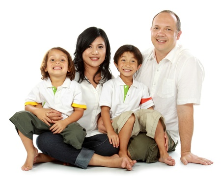mixed race: Beautiful mixed race family - isolated over a white background Stock Photo
