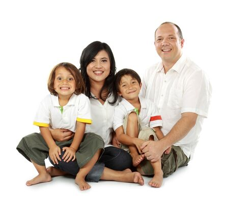 smiling happy family isolated on white background photo