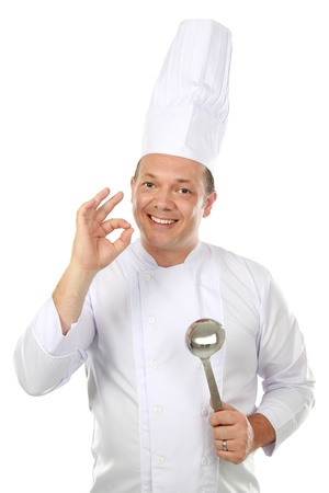 Smiling chef with oke sign. Isolated over white background photo