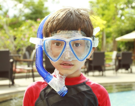Portrait of a kid with swimwear ready to swim photo