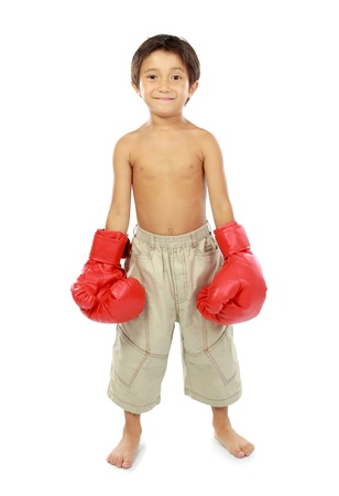 portrait of happy young kid with boxing glove isolated on white background photo
