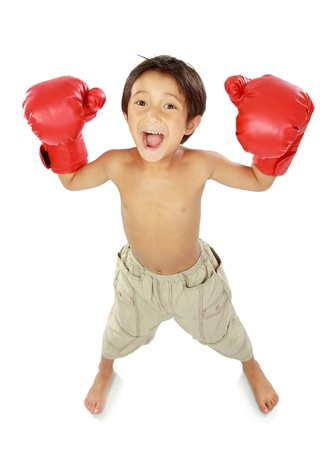 portrait of happy young kid with boxing glove in winning pose photo