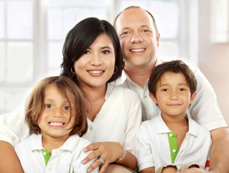 close up portrait of mixed race family in the living room photo