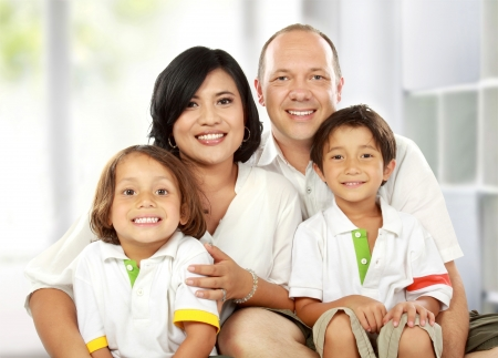 living together: Beautiful mixed race family in the living room