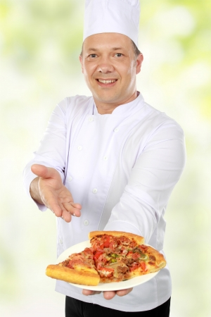 chef serving pizza in green nature background