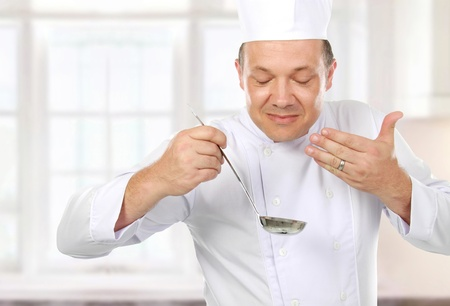 food testing: chef cooking and smell the food in the kitchen