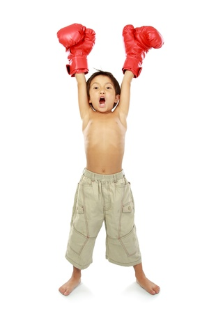 match box: portrait of happy young kid with boxing glove in winning pose